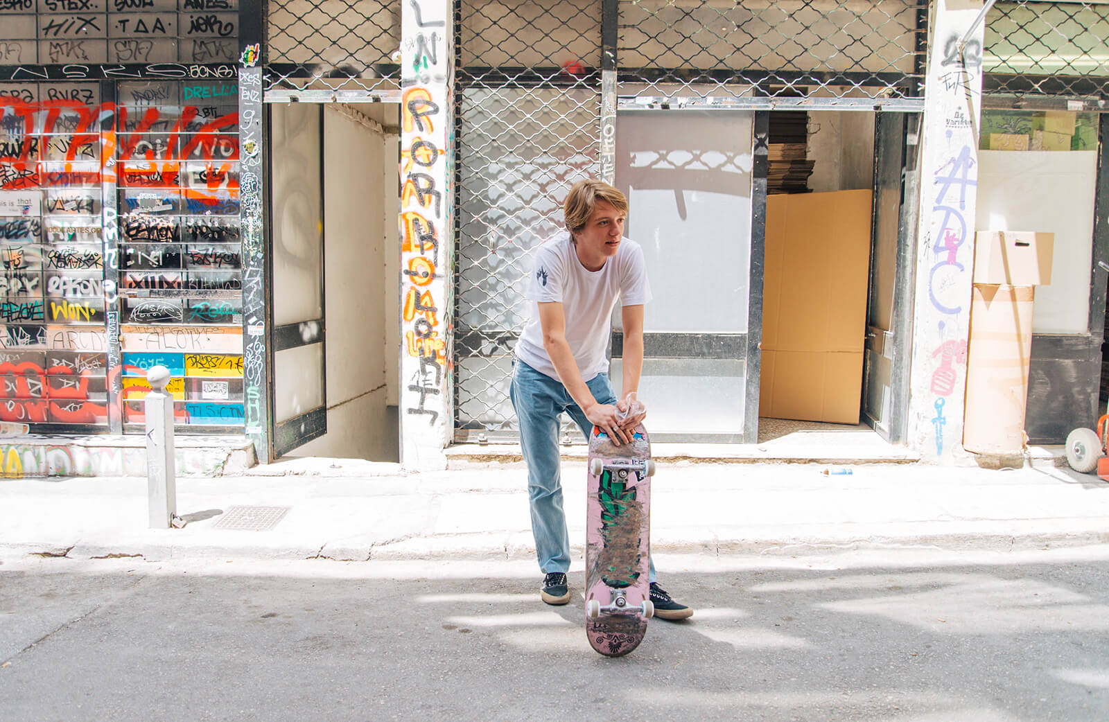 Skater resting at Protogenous Street, Athens