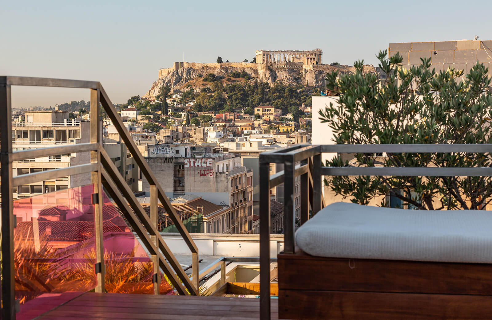 A shot of the Acropolis from a rooftop pool bar