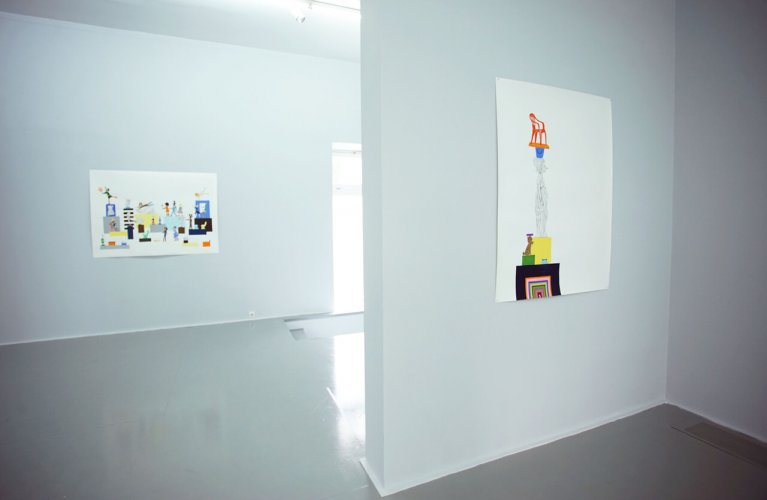 Paintings with yellow detail on white gallery walls