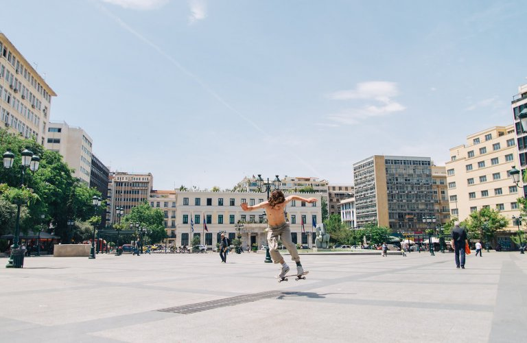 Teenager skating at Kotzia Square, Athens