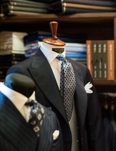 mannequins dressed with men's suits