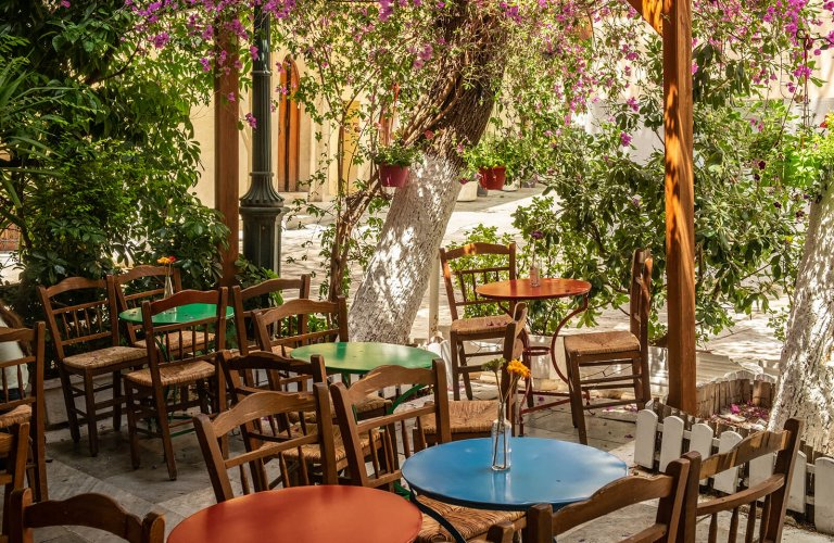 Traditional tables and chairs at Glykis in Plaka, Athens.