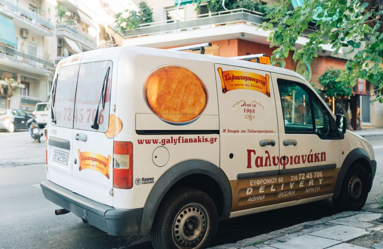 A Galifianaki pastry shop van parked on a street in Athens.