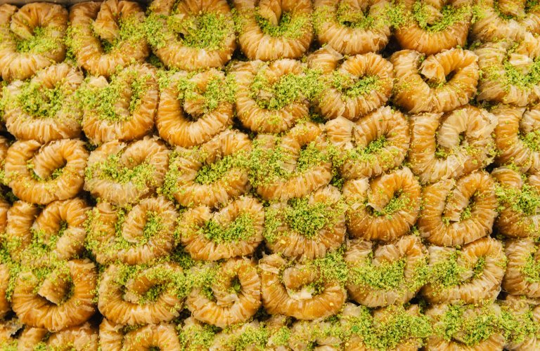 A close up of rows and rows of small baklava.