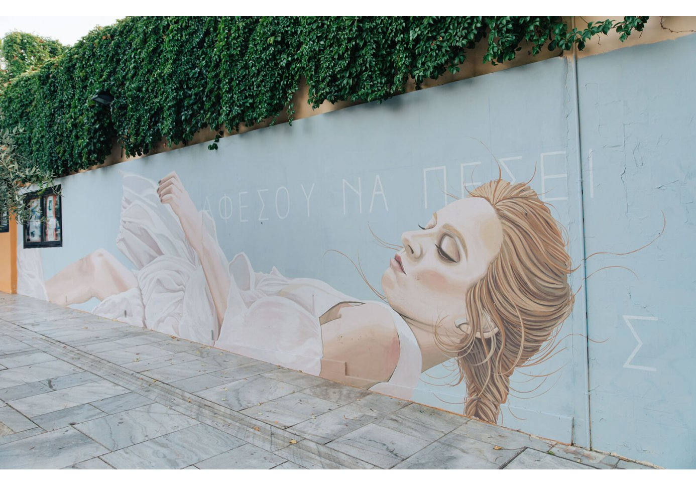 Let Yourself Fall by Duo Amazonas graffiti on the wall of Thiseion cinema in Athens.