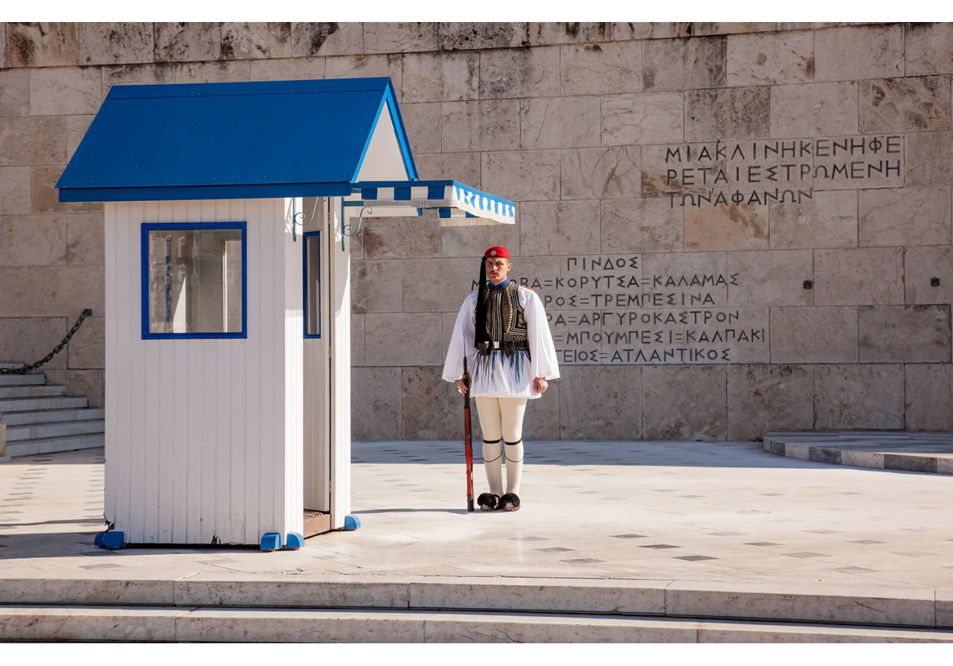 an Evzone standing guard in front of the Greek Parliament in Athens