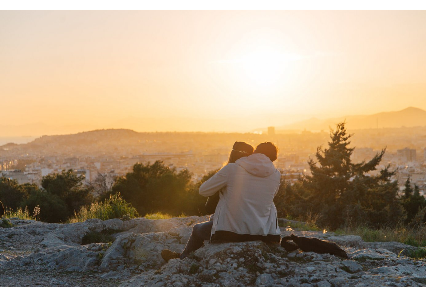 a couple hugging during sunset in Athens